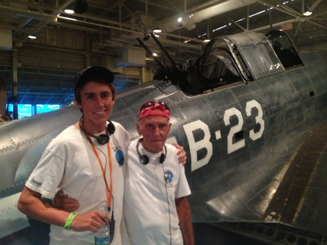 Dad and grandson Matthew in front of a Douglas SBD Dauntless aircraft at the Pacific Aviation Museum Pearl Harbor in 2014.